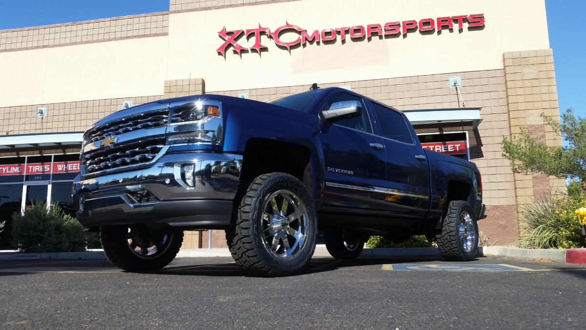 "Tony brought us his 2016 1500 2WD Silverado for a Maxtrac Suspension 3"" lift spindle with stainless steel braided brake lines, Fox Racing front 2.0 Performance Series Coil-over & Fox Racing rear 2.0 Performance Series shocks, Fabtech Motorsports rear blocks for a perfectly level truck, 1.5"" rear wheel spacers to accomodate the expanded track width in the front, 33x12.50R20 Toyo Tires Open Country R/T tires wrapped around 20"" Moto Metal Series 962 wheels, & AMP Research powersteps!"