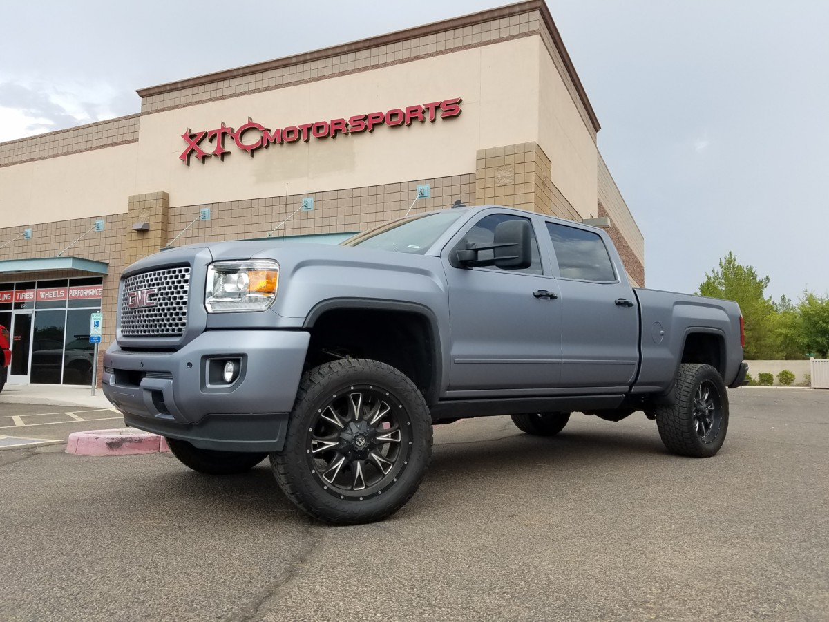 "Spencer brought his 2015 GMC 2500HD Denali a while back to have us put an ICON Vehicle Dynamics leveling kit and 2.5"" PiggyBack Reservoir shocks, 20"" Fuel Throttle wheels with some Nitto Terra Grappler G2 tires wrapped around them, & some AMP Research power steps on it. Well yesterday we added the CST Performance Suspension S.T.L. High Clearance 3-6"" suspension lift kit."