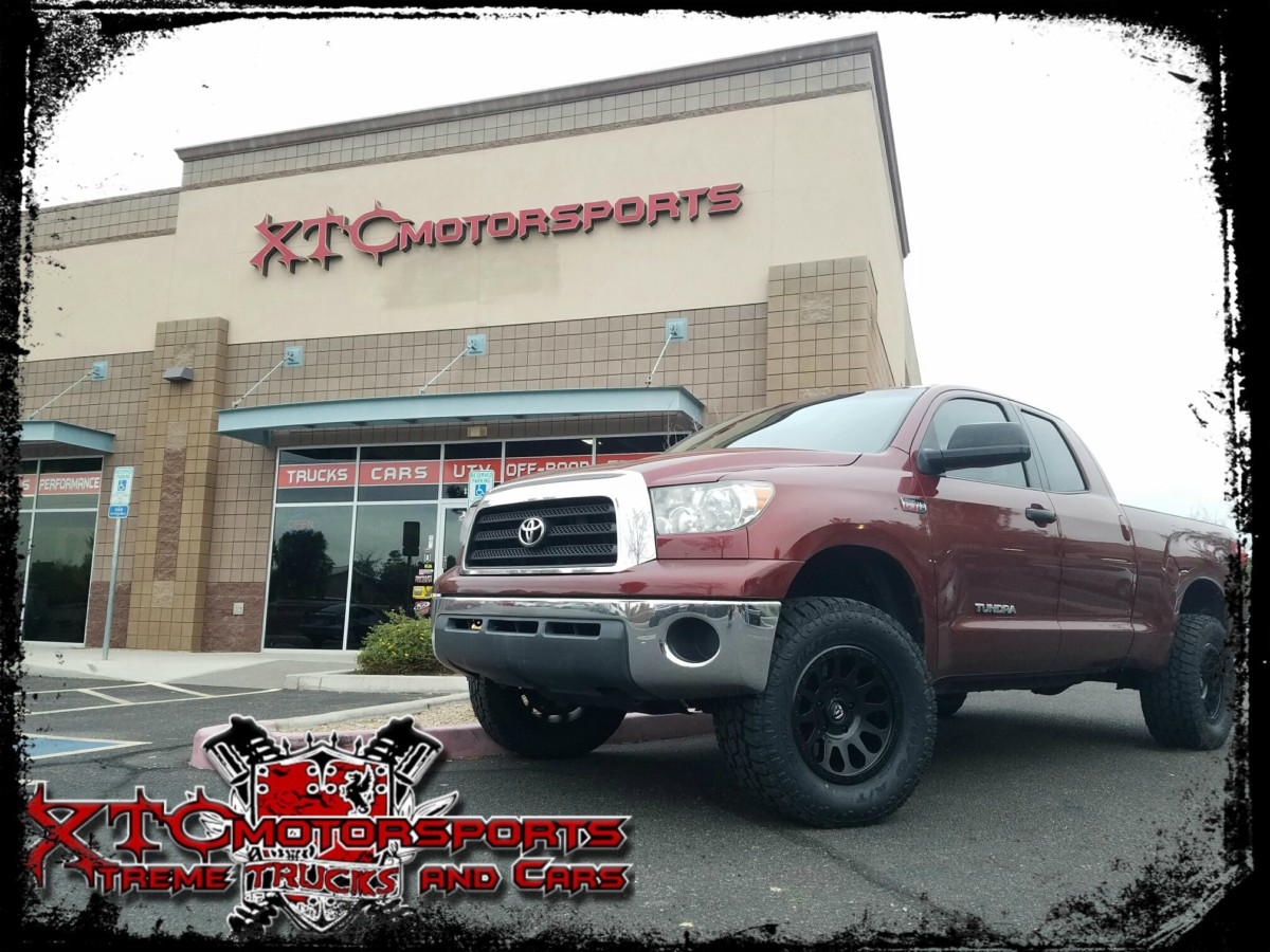 """Eric brought in his 2009 Toyota USA Tundra for a ReadyLift Suspension Inc. SST 3"""" front/1"""" rear suspension lift kit, Bilstein Shock Absorbers 4600 series struts/shocks, 325/60R18 Toyo Tires AT-II tires wrapped around some 18x9 Fuel Offroad D579 Matte Black Vector wheels."""