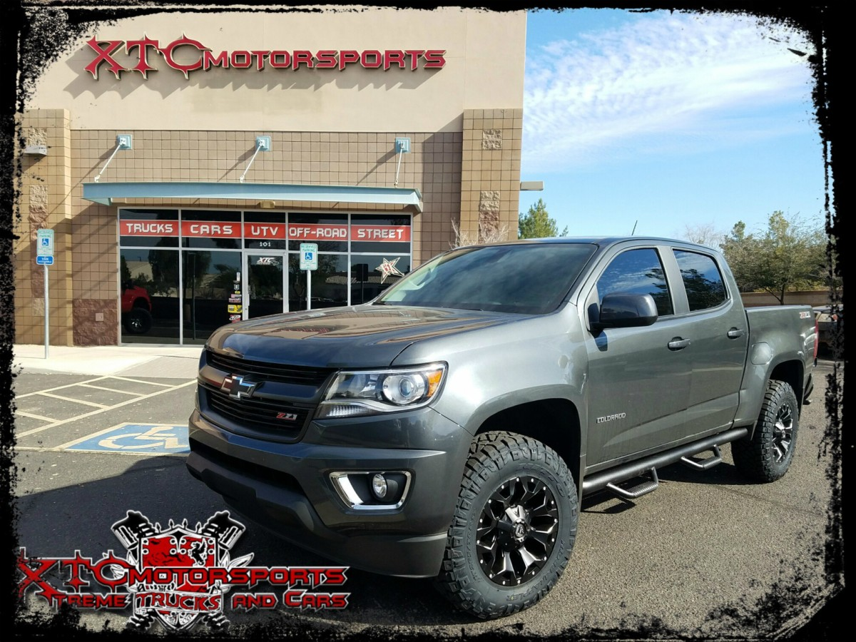 "Rich wanted to do some upgrades to his 2016 Chevrolet Colorado Z71 so he wanted XTC Motorsports to do the work for him. We installed a ReadyLift Suspension Inc. 2"" leveling kit with some 265/70R17 Nitto Tire Ridge Grapplers on some Fuel Offroad 17x8.5 Matte Black Assault wheels. We also installed a set of N-FAB nerf bars, window tint, & a spray in bed liner."