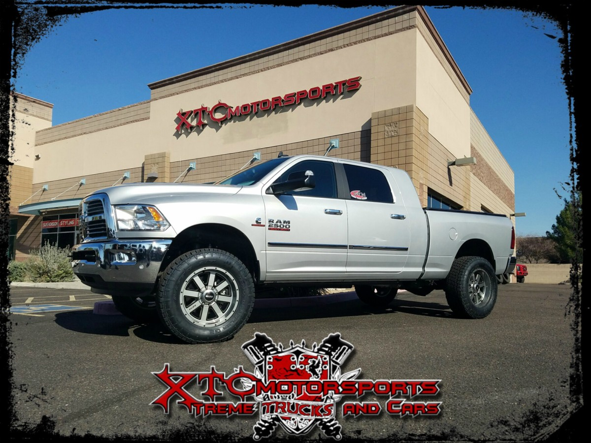 """Brent brought in his 2016 Ram 2500 Mega Cab for a Daystar 2"""" leveling kit with Fox Racing 2.0 series shocks, and some 295/65R20 Nitto Terra Grappler G2 tires on some Sota Off Road 20x9 A.W.O.L. Anthra-Kote with black accent wheels. AMP Research Power Steps."""