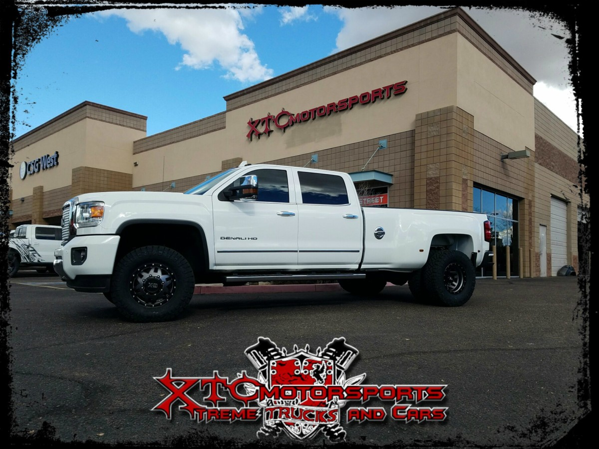 """Mike brought in his 2015 GMC Sierra 3500 Dually for a set of Cognito Motorsports Upper Control arms, Fox 2.0 series shocks, and some 285/75R17 Nitto Ridge Grappler tires wrapped around some 17"""" XD Series XD130 Grey w/black ring wheels."""
