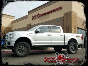 "Troy dropped his 2016 Ford Motor Company F150 Platinum for a ReadyLift Suspension Inc. 7"" suspension lift with Fox Racing 2.0 series rear shocks, some 35x12.50R20 Open Country ATII Toyo Tires wrapped around some 20x9 Moto Metal MO962 Satin Grey with Milled Accent wheels."