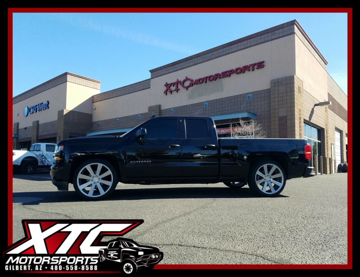 """TJ brought in his 2016 Chevrolet Silverado 1500 for a Belltech Sport Trucks 2""""/4"""" lowering kit and 295/35R24 Hercules Tires Ironman IMove GEN2 tires around a set of 24"""" Brushed face w/Silver window 8-BALL S213 Dub Wheels."""