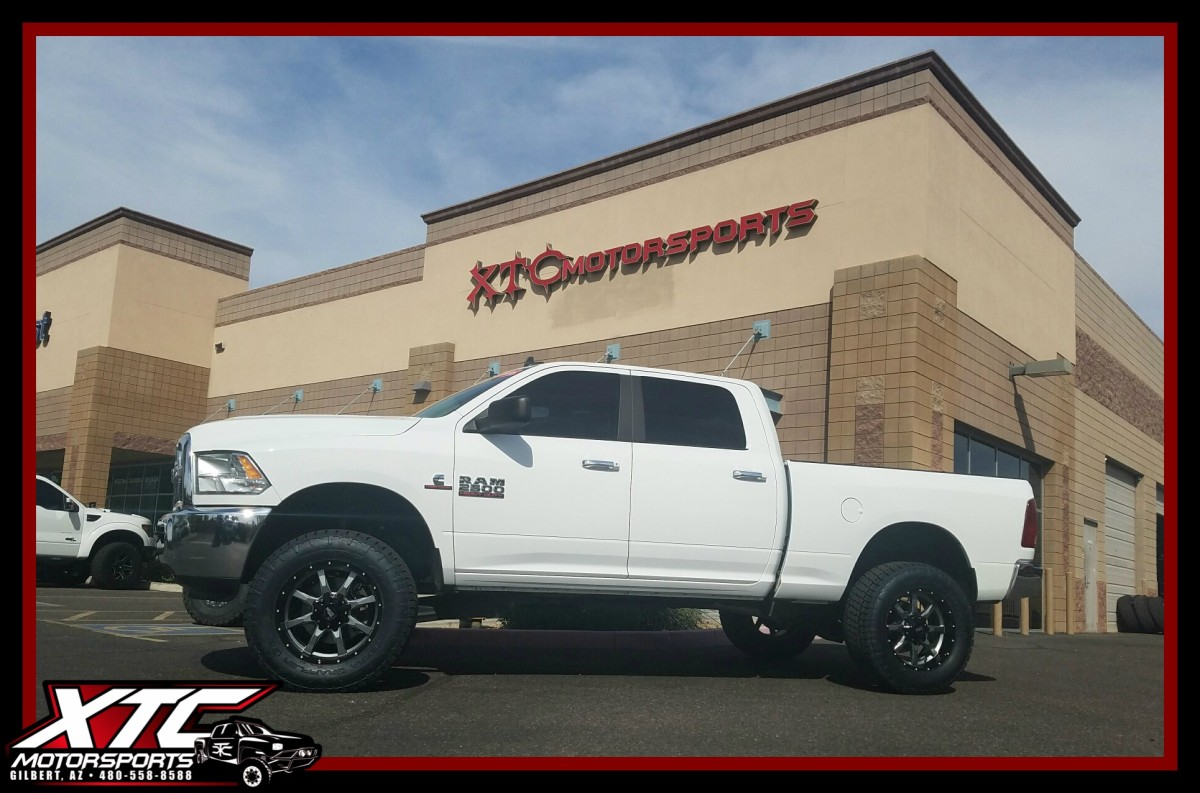 """Our friends over at azautorv.com wanted us to make this 2016 Ram 2500 look great on their lot, so we put a 3""""/1"""" ReadyLift Suspension Inc. SST kit on it with some N-FAB wheel-to-wheel nerf steps all of this standing tall on some 295/65R20 Nitto Tire Terra Grappler G2's wrapped around some 20x9 Moto Metal MO970 Grey w/black lip wheels."""