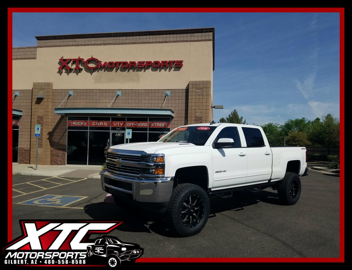 "Once again our friends over at azautorv.com brought us a truck to deck out for their lot, this time it was a 2016 Chevrolet Silverado 2500HD that got a 6"" ReadyLift suspension lift, a set of N-FAB nerf bars, 20"" Moto Metal MO970 Black with Machined face wheels wrapped with some 295/65R20 Nitto Tire Terra Grappler G2's."