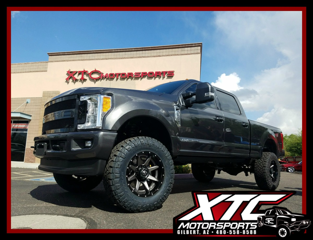 """Brandon drove down from the beautiful state of Colorado to have us deck out his brand new Ford Motor Company F-350 Super Duty. We installed a BDS Suspension 4"""" lift with ICON Vehicle Dynamics 2.5"""" PiggyBack Reservoir shocks, Airlift LoadLIfter 5000 airbags with a WirelessOne compressor system, AMP Research powersteps, a Kelderman Air Suspension Systems Alpha Series grille, all of this is propped up on a set of 37x12.50R20 Nitto Tire Ridge Grapplers wrapped around a set of Fuel Offroad D238 Anthracite center with gloss black lip rampage wheels."""