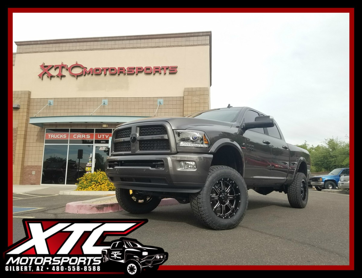"Our good buddy Stacey Adams brought in his 2017 Ram Trucks 2500 for a Readylift 4.5"" SST kit with FOX 2.0 series shocks, 295/65R20 Nitto Tire Terra Grappler G2's wrapped around a set of Gear Alloy Wheels Black and Machined Challengers, and to top it all off we put on a set of AMP Research power steps."