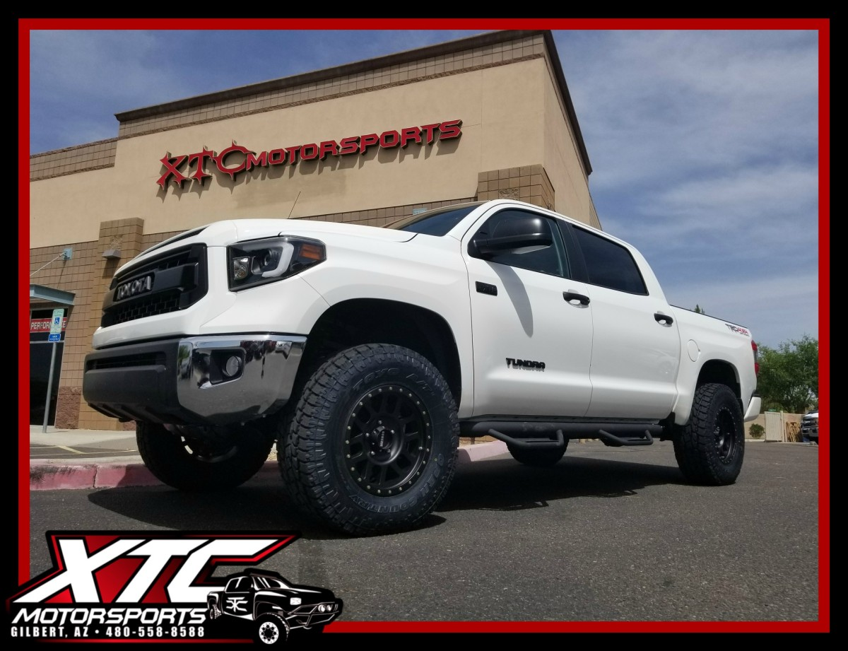 "Ali dropped off his 2017 Toyota USA Tundra for a set of Zone Offroad Products upper control arms with Fox Racing 2.5"" Remote Reservoir coilovers in the front and a set of 2.0 Reservoir shocks in the rear with a ReadyLift 1"" block kit, we also installed a set N-FAB Podium steps and a Bak Industries folding tonneau cover with vinyl top, and all of this is standing up on a set of 18x9 Method Race Wheels Black grids wrapped with a set of 35x12.50R18 Toyo Tires Open Country ATII's."