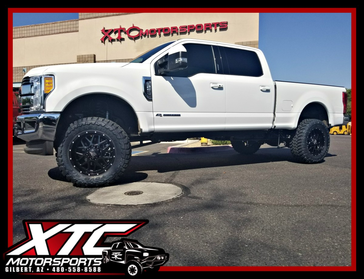 "Michael brought us his 2017 Ford Motor Company F250 Super Duty for a BDS Suspension 4"" radius arm suspension lift with Fox Racing 2.0 shox, a set of 35x12.50R20 Toyo Tires Open Country M/T's wrapped around a set of 20x9 KMC Wheels XD Series XD820 Satin Black Grenades, we also put on a set of AMP Research power steps."