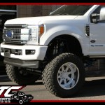 Colby brought in his 2017 Ford Motor Company F250 Super Duty for a BIGTIME overhaul. First we installed a custom blue powder coated Bulletproof Suspension 10-12