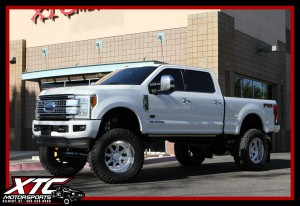 """Colby brought in his 2017 Ford Motor Company F250 Super Duty for a BIGTIME overhaul. First we installed a custom blue powder coated Bulletproof Suspension 10-12"""" lift with 2.5"""" Coil Overs, a set of 40x15.50R22 Toyo Tires Open Country M/T's wrapped around a set of custom painted Fuel Offroad Forged FF09 wheels. We also installed a Pace Edwards Truck Bed Tonneau Covers electric bed locker."""