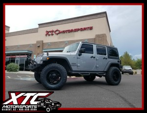"Mike brought his 2014 Jeep Wrangler JK Sport for a 3"" BDS Suspension lift with FOX 2.0 Shox, Smittybilt Carbine front bumper with a set of Rigid Industries - LED Lighting D2 Hyperspot lights and SRC rear bumper with swing away tire carrier, 5 Moto Metal Black Out MO977 Link wheels wrapped with a set of 35x12.50R18 Nitto Tire Ridge Grapplers."