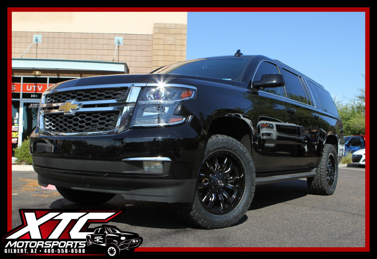 "Kevin drop off is 2016 Chevrolet Suburban for an XTC Motorsports 2.5"" leveling kit and a set of 295/55R20 Toyo Tires Open country ATII's wrapped around a set of 20x9 Fuel Offroad Gloss Black & Milled Sledge wheels."