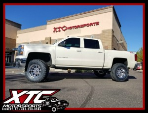 "Eric brought us his 2014 Chevrolet Silverado 1500 for a ReadyLift Suspension Inc. 6.5"" lift with rear FOX 2.0 Shox, 35x12.50R18 Toyo Tires M/T's wrapped around a set of KMC Wheels XD779 Chrome Badlands, & a set of AMP Research power steps."