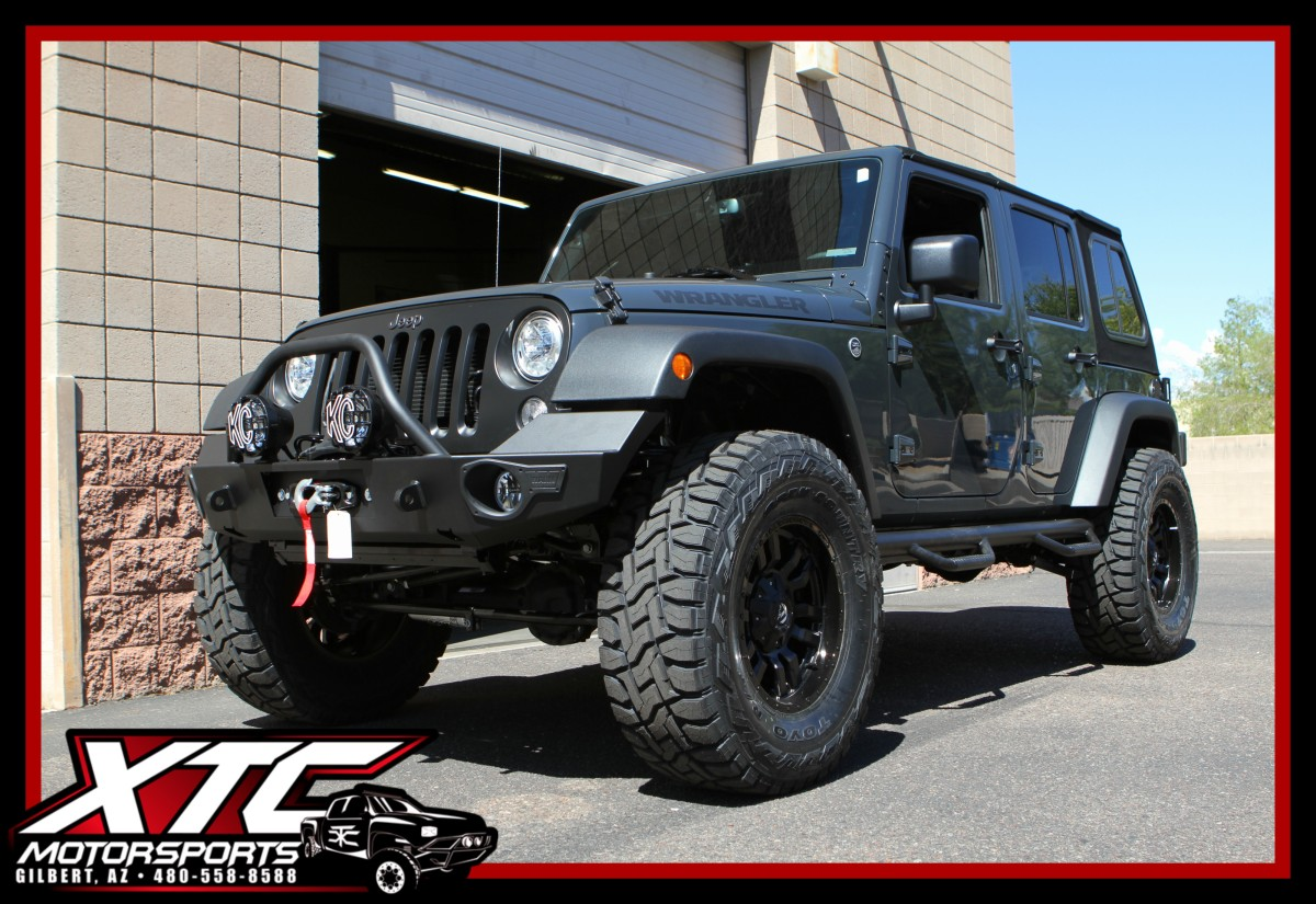 "We just wrapped up this awesome build for Josh. We took his 2017 Jeep Wrangler Unlimited and put a ReadyLift Suspension Inc. 4"" SuperFlex suspension lift with FOX 2.0 Performance Series Reservoir with CD Adjuster shocks on front & rear and a 2.0 Performance Series steering stabilizer, a set of 37x13.50R18 Toyo Tires Open Country R/T's wrapped around a set of Fuel Offroad 18x9 Matte Black w/ Gloss lip D596 Sledge wheels, WARN Elite series front & rear bumper with tire carrier and a VR8-S winch, KC HiLiTES, Inc. 4"" Gravity LED G4 fog lights with a set of 6"" Pro-Sport with Gravity LED G6 drive lights, G2 Axle & Gear 4.88 gears front and rear, N-FAB nerf steps, Borla Exhaust split rear cat-back system with black tips, Banks Power Ram-Air intake system and a Superchips Flashcal programmer."