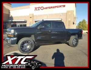 "David dropped off his 2017 Chevrolet Silverado 1500 for an XTC Motorsports 2.5"" leveling kit and a set of 22x12 2 piece Chrome with Gloss Black lip Fuel Offroad D270 Sledge wheels wrapped with a set of 33x12.50R22 Nitto Terra Grappler G2 tires."