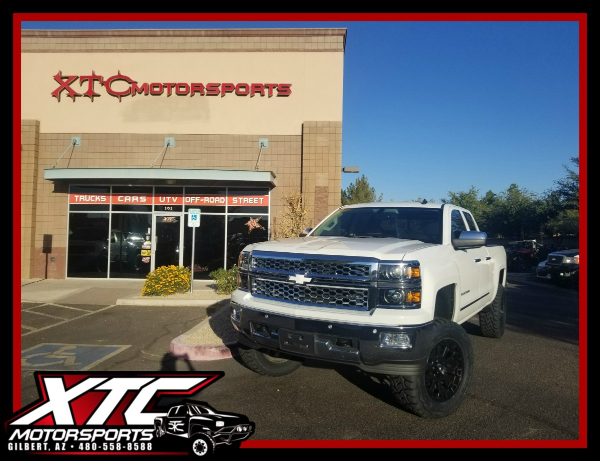 """John brought in his 2014 Chevrolet Silverado 1500 for a Zone Offroad Products 6.5"""" suspension lift, a set of 35x12.50R20 Toyo Tires Open Country R/T's on his KMC Wheels XD series XD800 Black Misfit wheels."""
