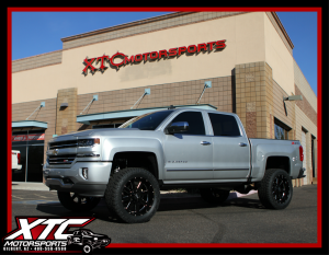 "Chris had us install a BDS Suspension 6"" Coil over suspension lift w/ FOX Coil overs & rear shocks, 22x10 Moto Metal MO962 Gloss black & milled wheels wrapped with a set of 35x12.50R22 Toyo Tires Open Country ATII's, and a set of AMP Research power steps."