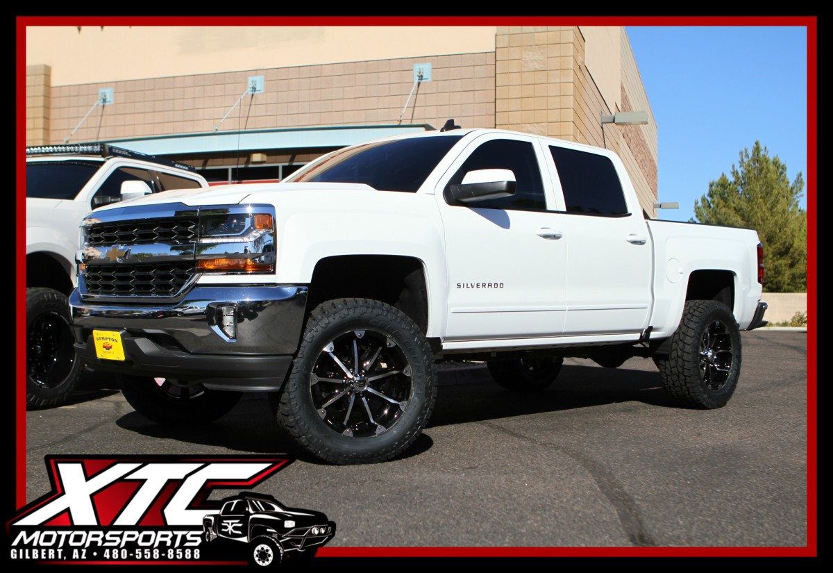 """Eddie brought in his 2018 Chevrolet Silverado 1500 for a CST Performance Suspension 5.5"""" spindle lift with Bilstein 5100 series rear shocks, a set of 35x12.50R20 Toyo Open Country AT2 tires wrapped around a set of KMC XD Series XD779 Gloss Black & Machined Badlands wheels."""