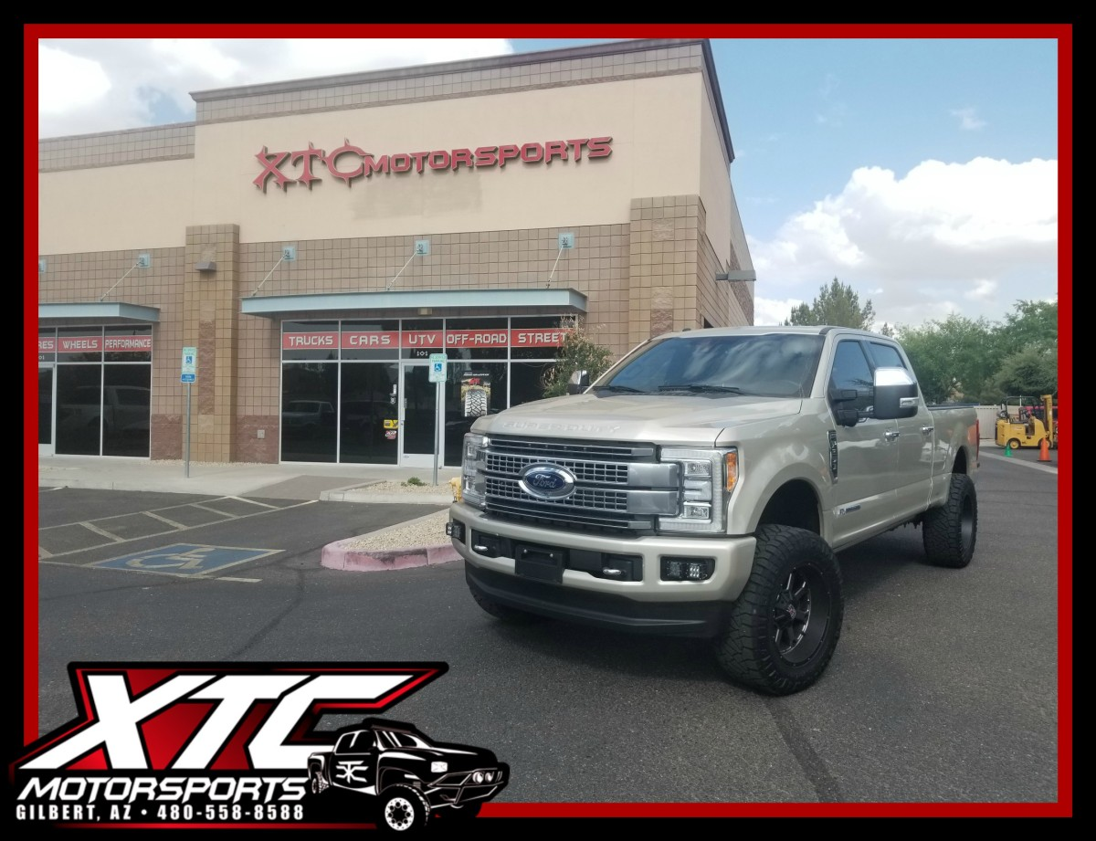 """It's been a few weeks but Ryan had us install an ICON Vehicle Dynamics Stage 5 2.5"""" suspension system, a set of KMC XD Series XD825 20x10 Matte Black w/ Double Dark Tint wheels wrapped with a set of 35x12.50R20 Nitto Ridge Grappler tires, Rigid Industries dual fog light kit, a set of Ride-Rite load leveling airbags with a VIAIR compressor & tank system, and a Kleinn Air Horns Demon Model 730 powered by an XTC Power Products lit blue horn switch on his 2017 Ford F250 Super Duty."""