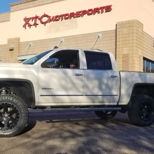 "We recently installed a 7"" MaxTrac spindle lift with Fox coilovers & rear shocks and 20x9 Fuel Offroad Gloss Black Ripper wheels, wrapped in a set of 35x12.50R20LT Nitto Ridge Grappler tires, on Scott's 2014 GMC Sierra 1500 Denali."