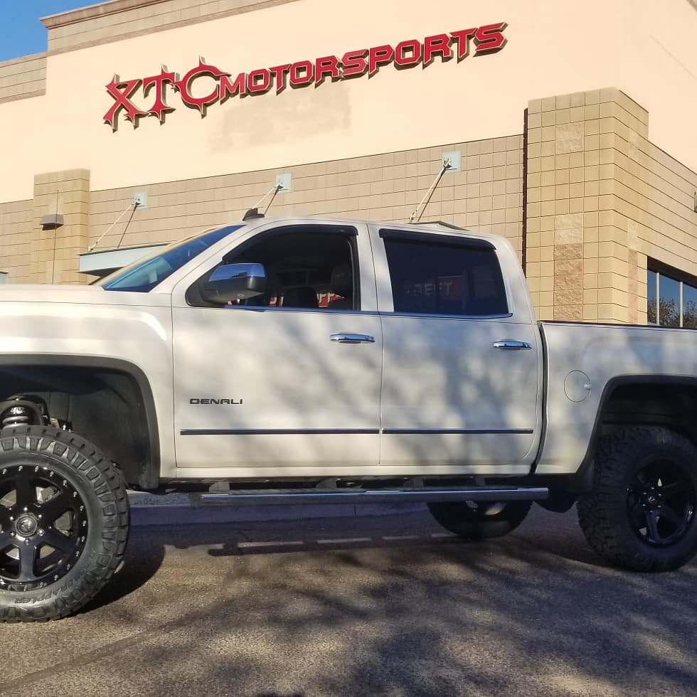 """We recently installed a 7"""" MaxTrac spindle lift with Fox coilovers & rear shocks and 20x9 Fuel Offroad Gloss Black Ripper wheels, wrapped in a set of 35x12.50R20LT Nitto Ridge Grappler tires, on Scott's 2014 GMC Sierra 1500 Denali."""